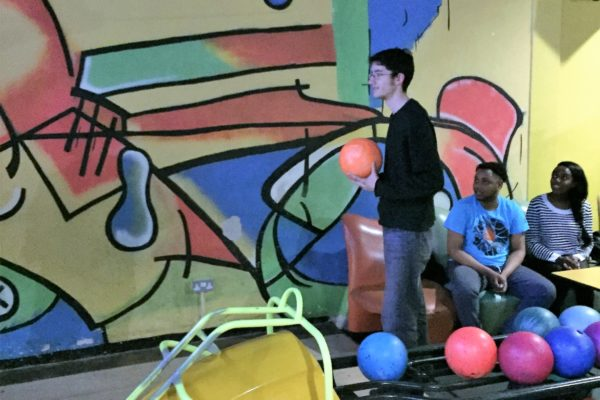 young adults bowling